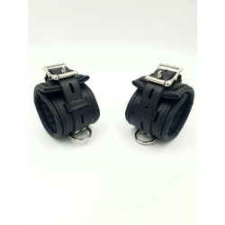 A set of leather hand clamps.